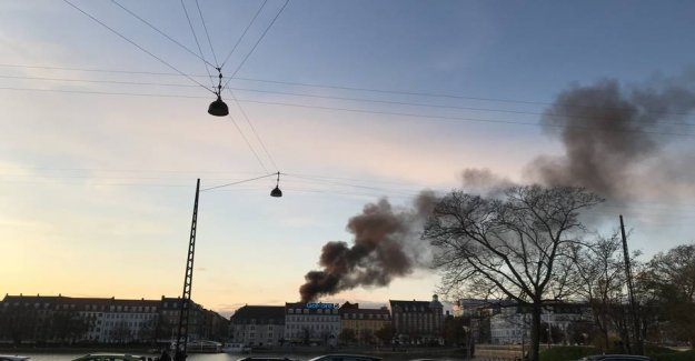 Tall flames and black smoke in Copenhagen
