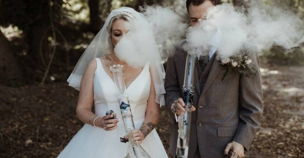 In the smoke and steam: Couple smoking bong after marriage