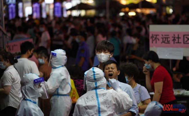 Chinese Town Guards down Area Following virus upsurge