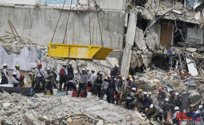 Biden will visit the site of the collapsed tower; search for it continues into 6th day