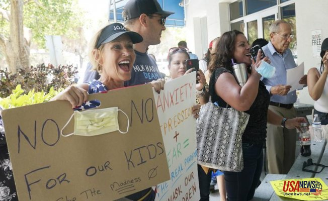 Parents are divided by mask guidance as they enter a new school year