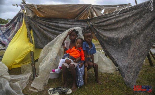 A tropical storm fuels anger in earthquake-stricken Haiti
