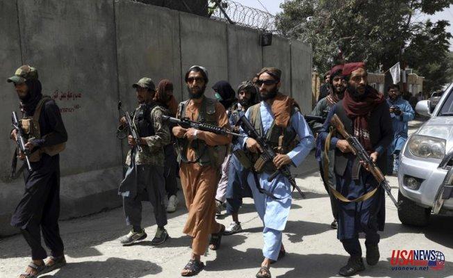 Taliban militants violently disperse a rare Afghan protest