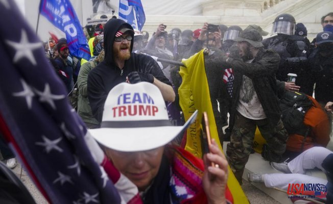 Capitol rally aims to rewrite January 6 by exalting the rioters