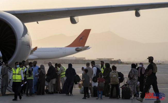 Many Westerners fly out of Kabul, including Americans