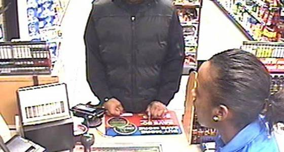 Busy middle-aged robber grabbing smokes by the carton, punching Twin Cities clerks