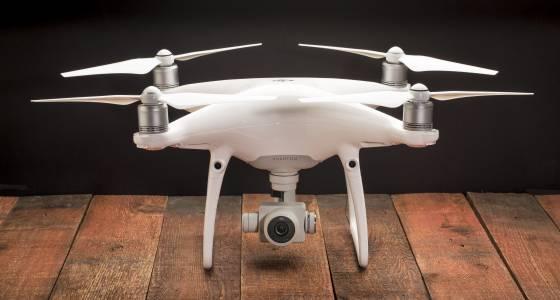 Drone smashes through woman's apartment window