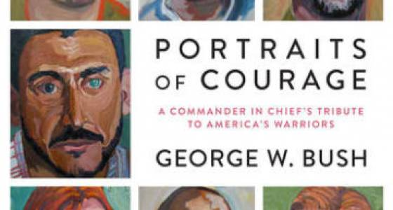George W. Bush autographing his book of 'warriors' portraits at MacDill