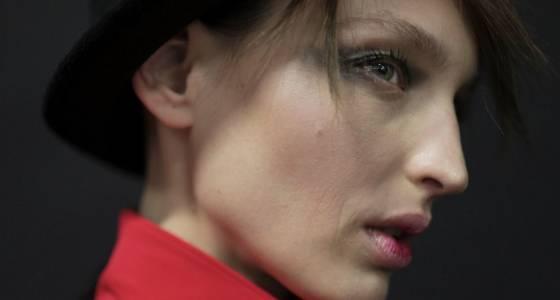 Giorgio Armani previews new eyeshadow gel backstage during fashion show