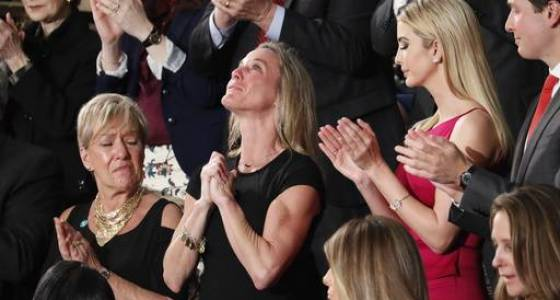 In emotional moment, Trump salutes slain SEAL's wife