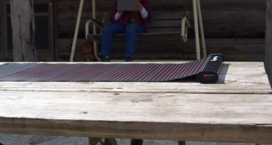 Lightweight thin-film solar charger is rollable, and includes a battery bank