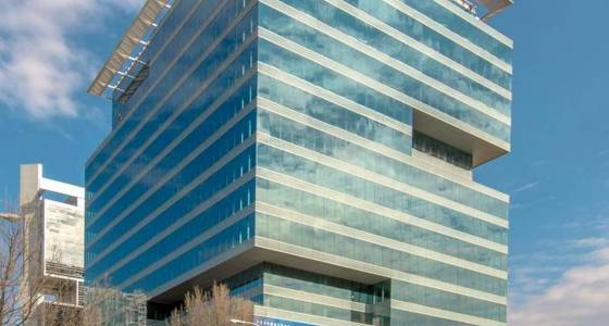 New uptown office tower signs a tenant
