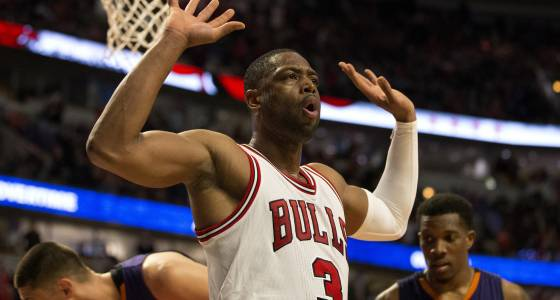 Old fashioned: Dwyane Wade and Jimmy Butler huge in overtime victory over Suns