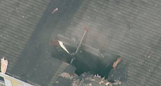 Pilot dead after small plane crashes into condo building