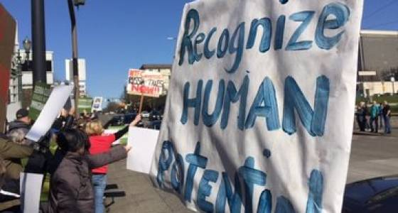 Protesters gather outside Oregon Convention Center to support immigrant rights