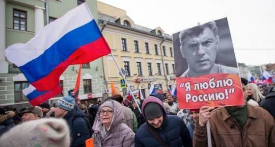 Russians march to honor slain opposition leader and Putin critic Boris Nemtsov