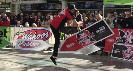 Sign spinners' moves nab attention on street and at contest