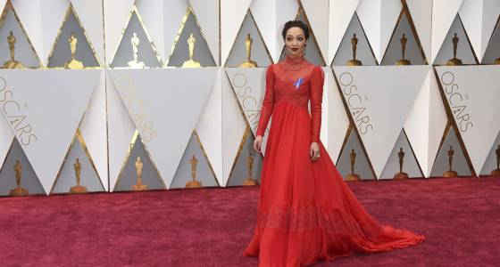 The Latest: Oscars bleacher fans draw celebrity attention.