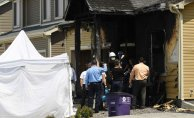 Three individuals in white masks have been found burning down the family's house