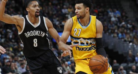 Nuggets roll past Nets at home