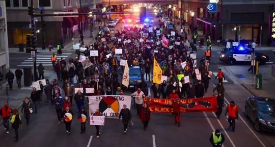 Protesters snarl rush-hour traffic, denounce Trump, urge $15 minimum wage