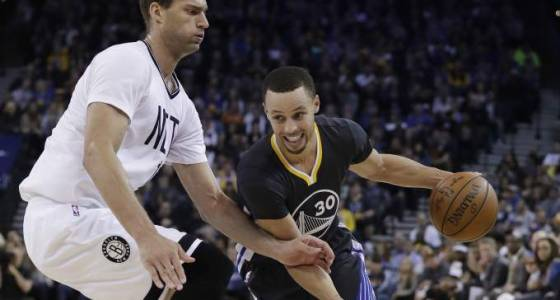 Warriors clinch playoff spot with win against Nets